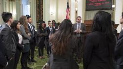 Assemblymember Wood Visits with Dental Students on the Assembly Floor
