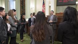 Assemblymember Wood Speaks with Dental Students on the Assembly Floor