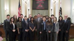 Assemblymember Wood on Assembly Floor with a Visiting Group of Dental Students in front of dais