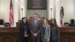 Assemblymember Wood with UCLA Dental Students on Assembly Floor - Close Up