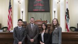 Assemblymember Wood with Western Dental Students on Assembly Floor - Close Up